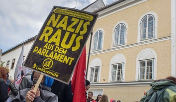 File photo: Protesters outside the house where Adolf Hitler was born during an  anti-Nazi protest in Braunau Am Inn, Austria on April 18, 2015.