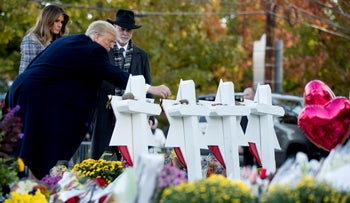 File photo: U.S. President Donald Trump places a stone from the White House at a memorial for those killed at the Tree of Life Synagogue in Pittsburgh, October 30, 2018.