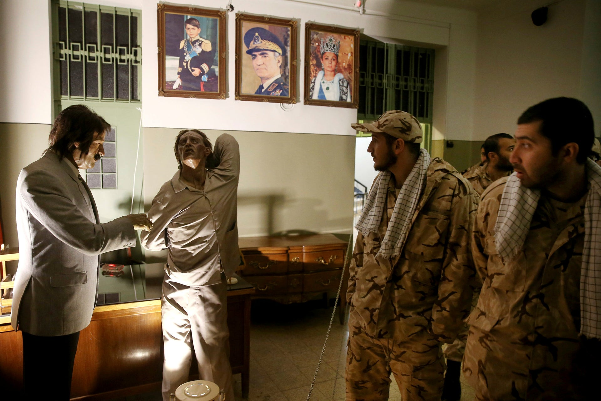 Iranian Revolutionary Guard soldiers look at an exhibition at former SAVAK prison in Tehran, Iran, January 7, 2019.