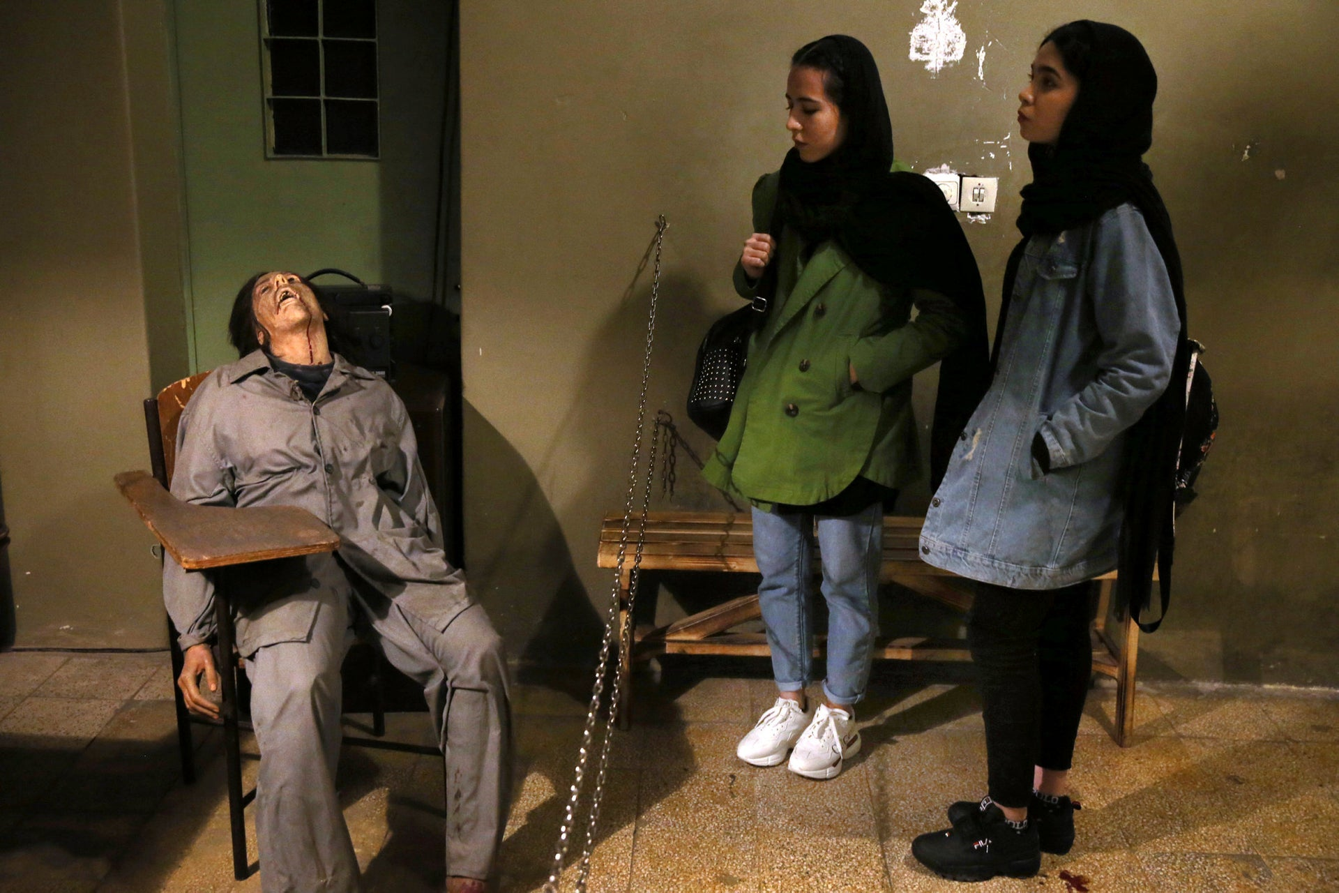 Women look at an exhibition at a former SAVAK prison, where a wax mannequin of a tortured female prisoner is on display, in Tehran, Iran, January 7, 2019.
