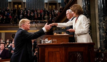 U.S. President Donald Trump greets Speaker of the House Nancy Pelosi, alongside Vice President Mike Pence, as he arrives to deliver the State of the Union address, February 5, 2019.