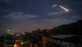 FILE PHOTO: Syrian air defence batteries responding to what the Syrian state media said were Israeli missiles targeting Damascus, January 21, 2019