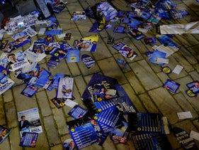 Campaign flyers litter the ground at the Likud primaries, Tel Aviv, February 5, 2019.