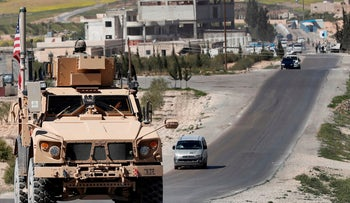 FILE PHOTO: A U.S. armored vehicle on a road leading to the front line with Turkish-backed fighters, in Manbij, north Syria, April 4, 2018