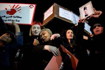 Women attend a protest against violence against women in Tel Aviv, Israel, Tuesday, Dec. 4, 2018