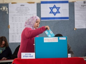 An Arab woman voting in the 2015 elections for the Israeli Knesset in Beit Safafa. 18 March 2015