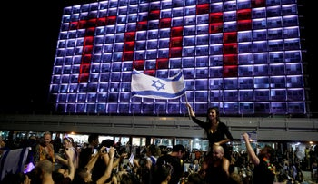 People celebrate the winning of the Eurovision Song Contest 2018 by Israel's Netta Barzilai with her song 'Toy,' at Rabin square in Tel Aviv, May 2018.
