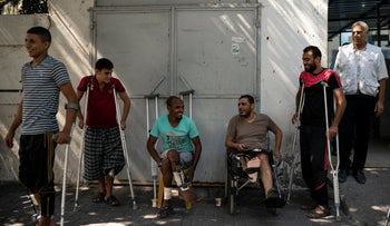 Patients with leg injuries they attained during demonstrations, gather outside a clinic run by MSF in Gaza City, September 10, 2018.