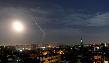 Photo released by the Syrian official news agency SANA, shows missiles flying into the sky near international airport, in Damascus, Syria, , Jan. 21, 2019.