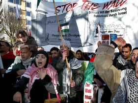 Palestinian protesters demonstrate in front of the International Court of Justice in The Hague, the Netherlands.