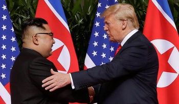 In this June 12, 2018 file photo, President Donald Trump shakes hands with North Korea leader Kim Jong Un at the Capella resort on Sentosa Island in Singapore.