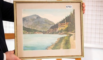 The watercolor entitled 'Ortschaft an Vorgebirgssee,' signed 'A. Hitler,' on display at the Weidler auction house in the southern city of Nuremberg.