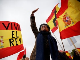 Demonstrators wave Spanish flags during a protest in Madrid, Spain, on Sunday, February 10, 2019.