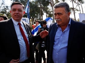 Labor Party chairman Avi Gabbey with lawmaker Amir Peretz in Tel Aviv, February 11, 2019