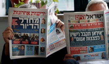 Yedioth Ahronoth, Israel's mass-circulation daily paper, left, and Israel Hayom, the free pro-Netanyahu newspaper owned by American casino tycoon Sheldon Adelson.