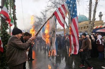 Iranians burn Israeli and American flags during celebrations for the 40th anniversary of the Islamic Revolution, Tehran, February 11, 2019.