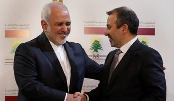 Lebanese Foreign Minister Gebran Bassil, shakes hands with his Iranian counterpart Mohammad Javad Zarif, in Beirut, Lebanon, February 11, 2019.