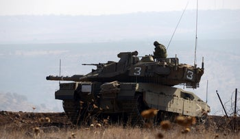 File Photo: Israel Defense Forces tank stationed on the border with Syria, November 27, 2018.