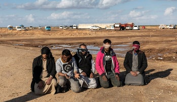 Men who had been arrested by Syrian Democratic Forces soldiers over suspected links to the Islamic State, Syria, January 30, 2019.