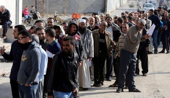 Palestinian Hamas-hired employees wait to receive their salaries, in the southern Gaza Strip November 9, 2018.