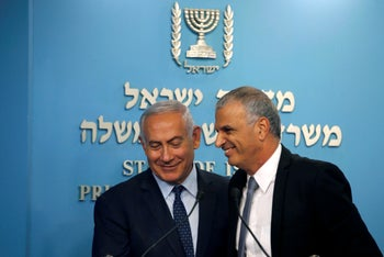 Netanyahu and his Finance Minister Moshe Kahlon smile during a news conference announcing the appointment of the new Bank of Israel Governor, in Jerusalem October 9, 2018.