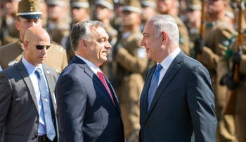 FILE PHOTO: Prime Minister Benjamin Netanyahu and his Hungarian counterpart Viktor Orban share a light moment during the reception ceremony in front of the Parliament building in Budapest, Hungary, July 18, 2017.