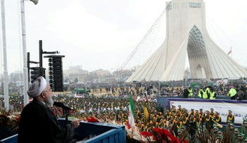 Iran's President Hassan Rohani speaks during a ceremony to mark the 40th anniversary of the Islamic Revolution