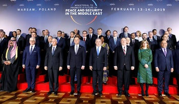 Participants pose for a photo at the Middle East conference at the Royal Castle in Warsaw, Poland, February 13, 2019.