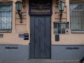"The front door of Azov's Cossack House in Kiev, Ukraine. The text above the door says: ""Let's restore the greatness of our ancestors."""