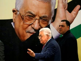 Palestinian President Mahmoud Abbas gestures during a ceremony marking the 54th anniversary of Fatah's founding, in Ramallah, in the Israeli-occupied West Bank December 31, 2018
