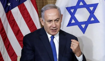 Israeli Prime Minister Benjamin Netanyahu reacts during a bilateral meeting with United States Vice President Mike Pence in Warsaw, Poland, Thursday, February 14, 2019.