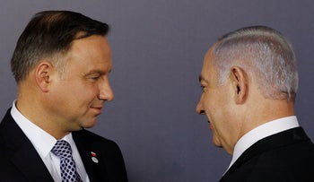 Polish President Andrzej Duda and Israeli Prime Minister Benjamin Netanyahu talk after a group photo at the Royal Castle in Warsaw, Poland, Wednesday, February 13, 2019.