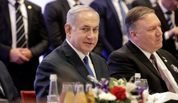 Prime Minister Benjamin Netanyahu and U.S. Secretary of State Mike Pompeo, right, at a conference on Peace and Security in the Middle East in Warsaw, Poland, Thursday, February 14, 2019.