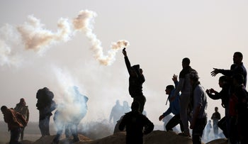 A Palestinian demonstrator holds a tear gas canister fired by Israeli forces during a protest at the Israel-Gaza border fence, in the southern Gaza Strip February 1, 2019.