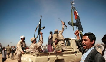 FILE Photo: Houthi rebels chant slogans during a gathering aimed at mobilizing more fighters into battlefronts to fight pro-government forces, in Sanaa, Yemen.