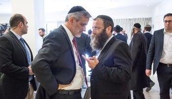 Eli Yishai and far-right politician Baruch Marzel in 2015.