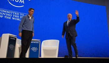 Fareed Zakaria, anchor for CNN, and Benjamin Netanyahu, Israel's prime minister, arrive for a special session at the World Economic Forum (WEF) in Davos, Switzerland, on Thursday, Jan. 21, 2016.