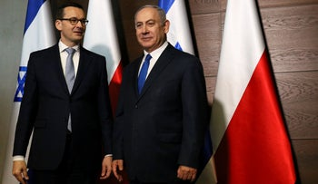 Israeli Prime Minister Benjamin Netanyahu poses for pictures with Poland's Prime Minister Mateusz Morawiecki during the Middle East summit in Warsaw, Poland, February 14, 2019.