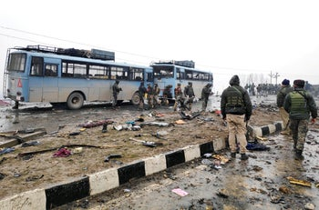 Indian soldiers examine the debris after an explosion in Lethpora in south Kashmir's Pulwama district February 14, 2019