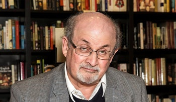 File Photo: Author Salman Rushdie signs a copy of his new book 'Home' at a book signing in London, United Kingdom, June 6, 2017.
