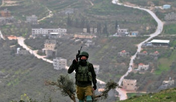 An Israeli soldier following a demonstration against Jewish settlements in the West Bank village of Urif, February 15, 2019.