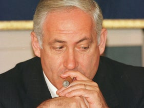 File photo: Israeli Prime Minister Benjamin Netanyahu draws his cigar during a press luncheon at the Foreign Correspondents' Club in Tokyo, August 26, 1997.