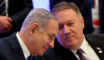 Israel's Prime Minister Benjamin Netanyahu and US Secretary of State Mike Pompeo talk as they attend the conference on Peace and Security in the Middle East in Warsaw. February 14, 2019