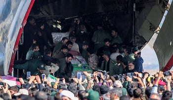 Iranians carry the coffins of members of Iran's elite Revolutionary Guards, who were killed by a suicide car bomb, at Isfahan airport, Iran February 14, 2019.
