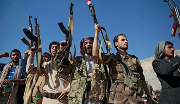 File Photo: Tribesmen loyal to Houthi rebels hold up their weapons as they attend a gathering to show their support for the ongoing peace talks being held in Sweden, in Sanaa, Yemen, December 13, 2018.