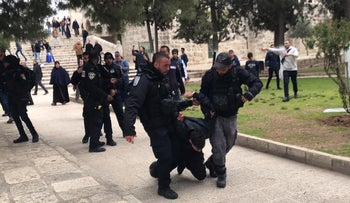 Police arrest a Palestinian at the Temple Mount, February 18, 2019.