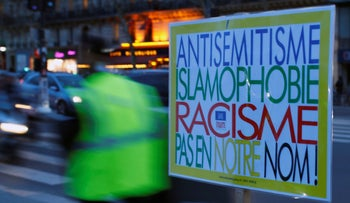 "A poster reading ""Anti-Semitism, Islamophobia, Racism, Not in Our Name"" during a gathering decrying anti-Semitism at Place de la Republique in Paris, France, February 18, 2019."