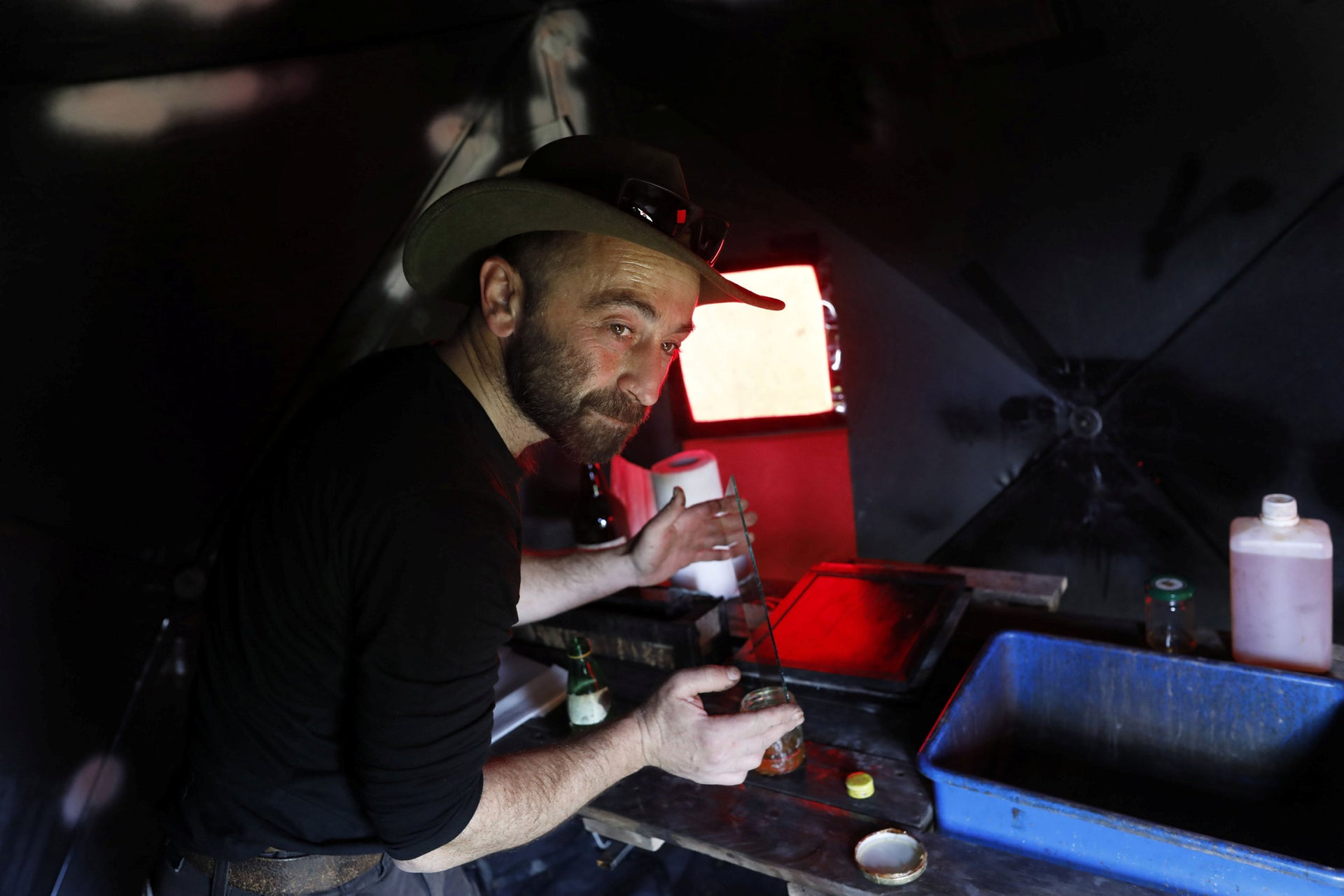 Photographer Edward Kaprov prepares a glass plate in his field darkroom, on February 5 2019.