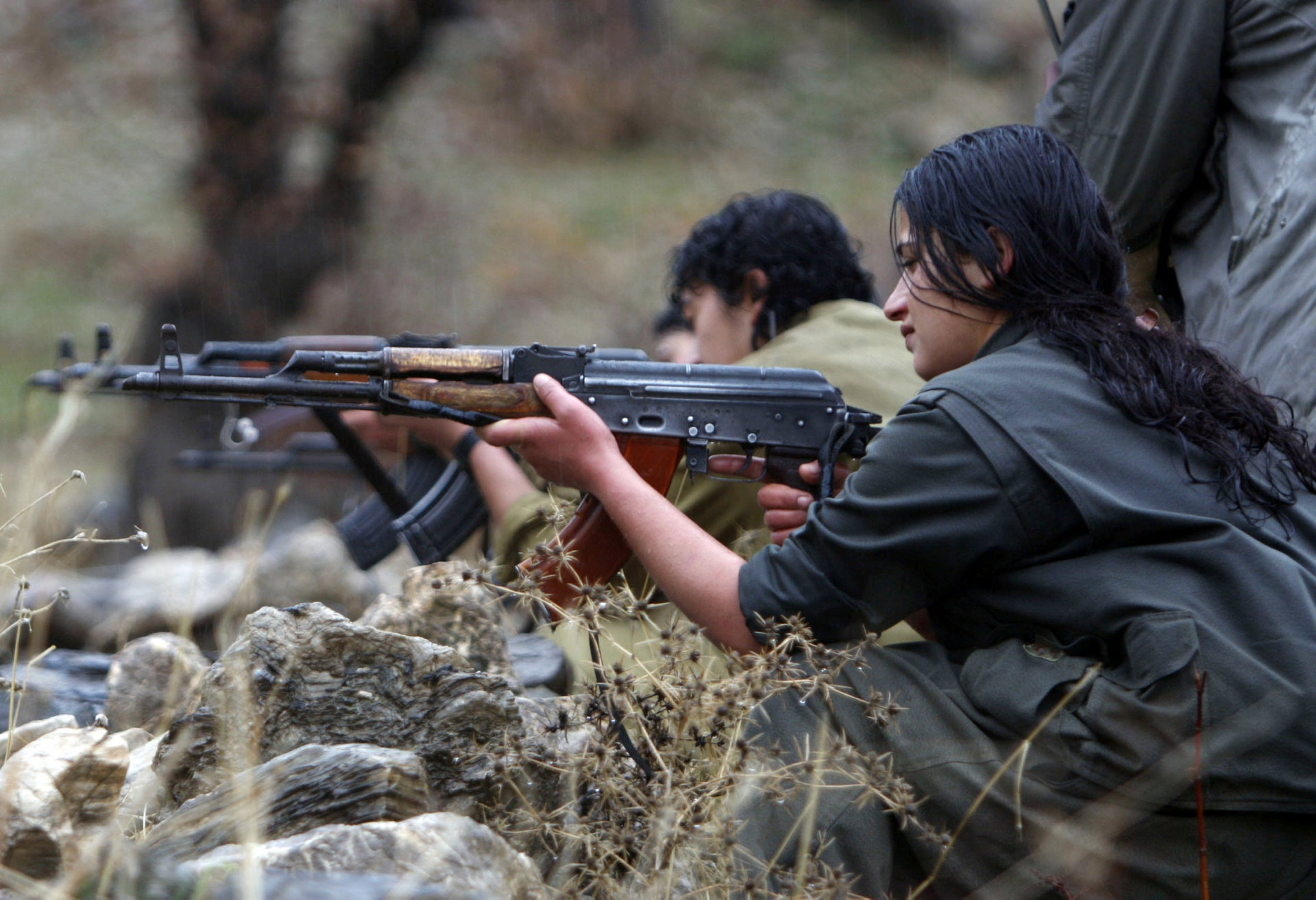 A member of PJAK trains on a weapon at the group's camp in the Qandil mountains in northern Iraq, December 18, 2009.