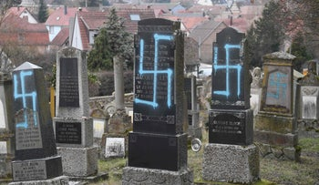The the desecrated graves in the village of Quatzenheim, near the city of Strasbourg, on February 19, 2019.
